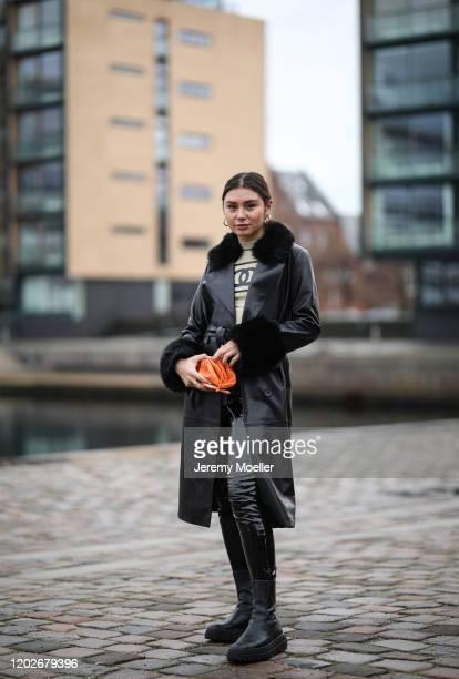 Milena Karl wearing a Chanel vintage top and Bottega Veneta orange mini bag wearing before Mykke Hofmann on January 28 2020 in Copenhagen Denmark