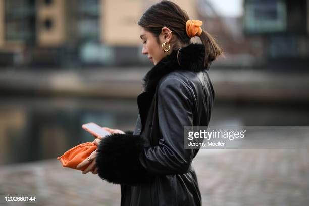 Milena Karl wearing a Chanel vintage top and Bottega Veneta orange mini bag wearing before Mykke Hofmann on January 28, 2020 in Copenhagen, Denmark.