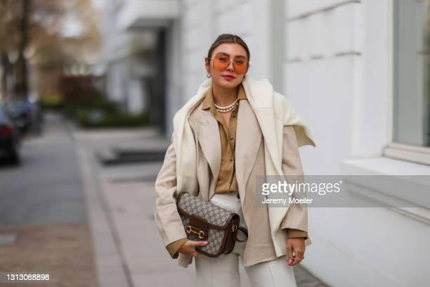 Milena Karl wearing beige Zara pants, beige by Aylin Koenig blazer and Gucci shades, bag and blouse on April 15, 2021 in Hamburg, Germany.