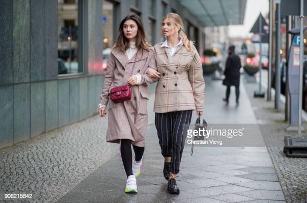 Milena Karl wearing checked coat red Chanel bag sneakers leggings and Xenia van der Woodsen wearing checked jacket striped pants Chanel bag is seen...
