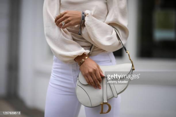 Milena Karl wearing Dior saddle bag, Gina Tricot top and Zara jeans on July 22, 2020 in Hamburg, Germany.