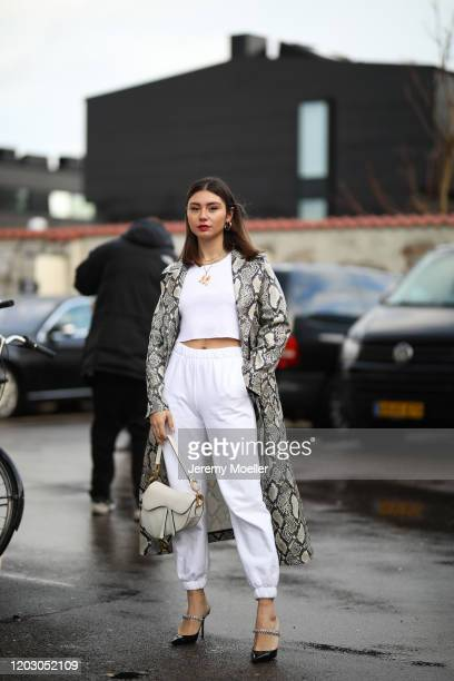 Milena Karl wearing Jimmy Choo heels, Dior saddle bag and a Stand Studio coat before Stand Studio on January 30, 2020 in Copenhagen, Denmark.