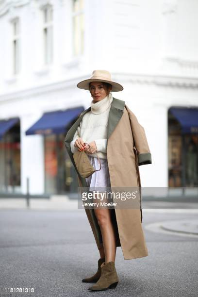 Milena Karl wearing Prada bag Isabel Marants boots and dress Iro belt Closed sweater and Ganni coat on October 14 2019 in Hamburg Germany