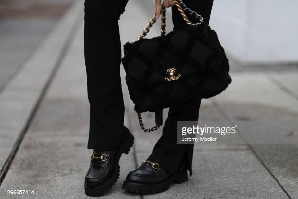Milena Karl wearing Zara pants, Gucci Loafer and Chanel Bag on January 14, 2021 in Hamburg, Germany.