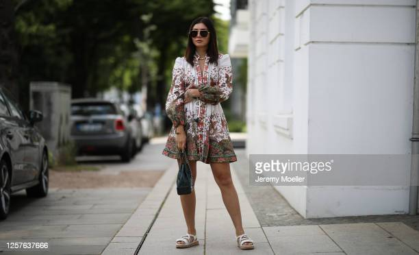 Milena Karl wearing Zimmermann dress, Chanel bag and sandals and Bottega Veneta shades on July 22, 2020 in Hamburg, Germany.