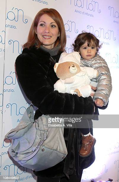 Milena Miconi and her daughter Agnese attend the Nanan Flagship Store Opening on January 27 2011 in Rome Italy