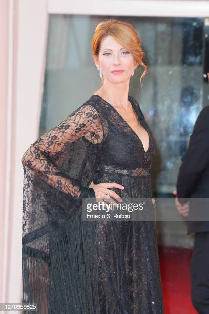 """Milena Miconi walks the red carpet ahead of the movie """"Khorshid"""" at the 77th Venice Film Festival on September 06, 2020 in Venice, Italy."""
