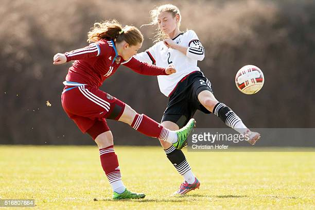 Milena Nikitina of Russia competes for the ball with Sarai Linder of Germany during the U17 Girl's Euro Qualifier match between Germany and Russia in...