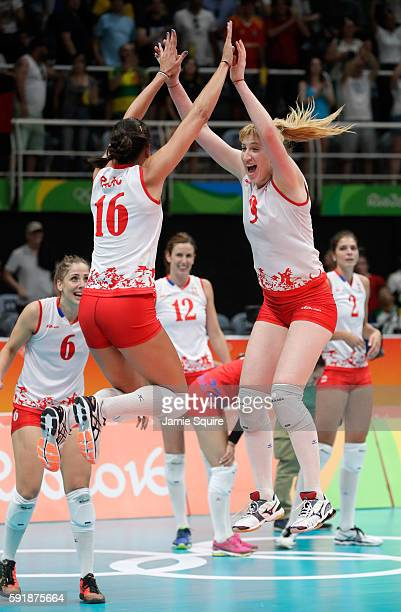 Milena Rasic and Brankica Mihajlovic of Serbia celebrate after defeating the United States in the Women's Volleyball Semifinal match at the...