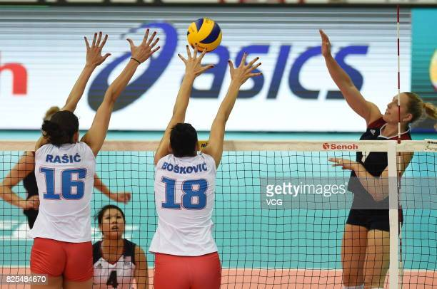 Milena Rasic of Serbia and Tijana Boskovic of Serbia block the ball during the group match of 2017 Nanjing FIVB World Grand Prix Finals between...