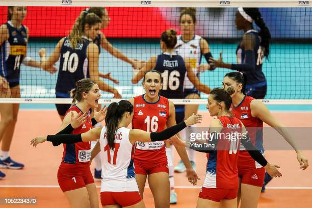 Milena Rasic of Serbia celebrates with teammates after winning a point during 2018 FIVB Volleyball Women's World Championship pool G match between...