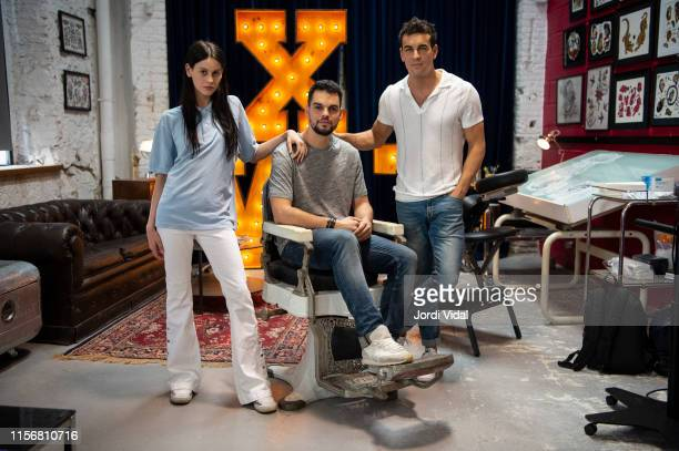 Milena Smit director David Victori and Mario Casas on the set of the film No Mataras at Tatoo Shop Nasty Garage on June 18 2019 in Barcelona Spain