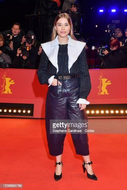 """Milena Tscharntke poses at the """"The Roads Not Taken"""" premiere during the 70th Berlinale International Film Festival Berlin at Berlinale Palace on..."""