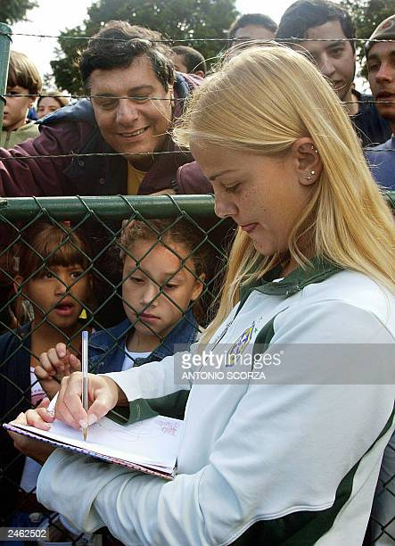 Milene Domingues, who is Ronaldo Nazario's wife and also female soccer player, signs autographs 04 September 2003, after the women soccer team...