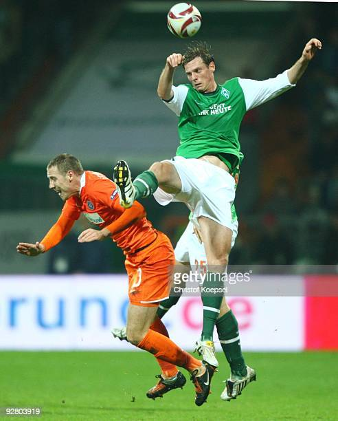 Milenko Acimovic of Austria and Tim Borowski of Bremen jump for a header during the UEFA Europa League Group L match between Werder Bremen and...