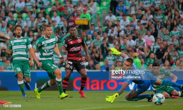 Miler Blaños of Xolos kicks the ball to score the first goal of his team during the 6th round match between Santos Laguna and Tijuana as part of the...