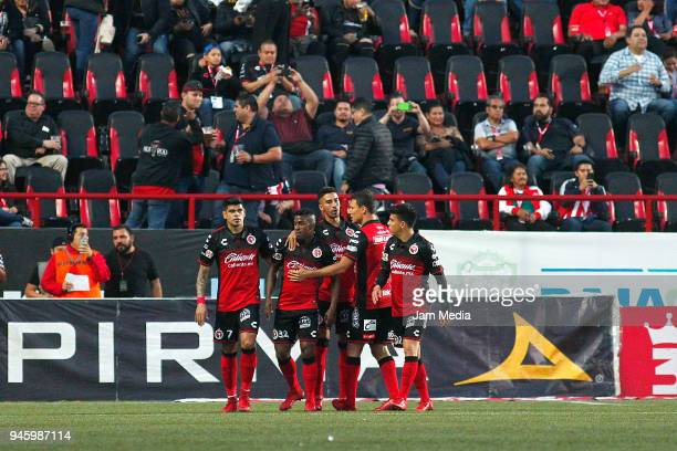 Miler Bolanos of Tijuana celebrates with teammates after scoring the first goal of his team during the 15th round match between Tijuana and Chivas as...