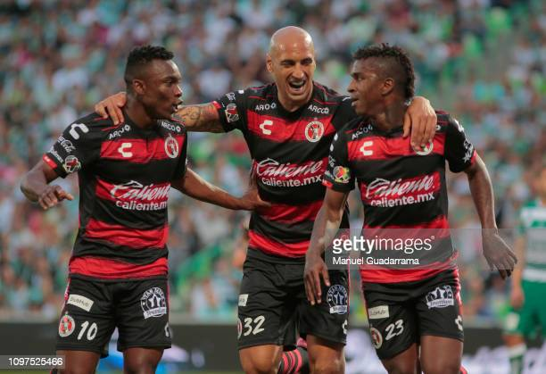 Miler Bolaños of Xolos celebrates with his teammates after scoring the first goal of his team during the 6th round match between Santos Laguna and...