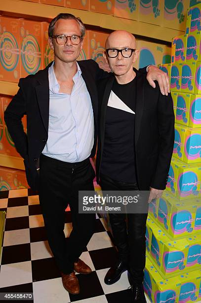 Miles Aldridge and James Gager attend the MAC x Dazed x Miles Aldridge party at White Rabbit on September 14 2014 in London England