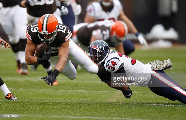 Miles Austin of the Cleveland Browns gets tripped up by AJ Bouye of the Houston Texans during the first quarter at FirstEnergy Stadium on November 16...