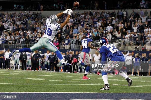 Miles Austin of the Dallas Cowboys fails to pull in a game ending pass in the end zone against Corey Webster of the New York Giants in the last play...