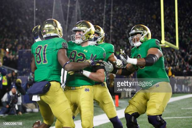 Miles Boykin of the Notre Dame Fighting Irish celebrates with teammates after a threeyard touchdown reception against the Florida State Seminoles in...