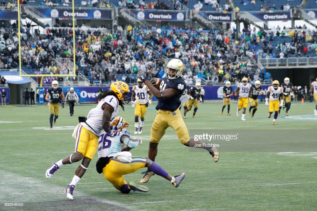 Miles Boykin #81 of the Notre Dame Fighting Irish gets away from LSU Tigers defenders for the game-winning 55-yard touchdown in the fourth quarter of the Citrus Bowl on January 1, 2018 in Orlando, Florida. Notre Dame won 21-17.