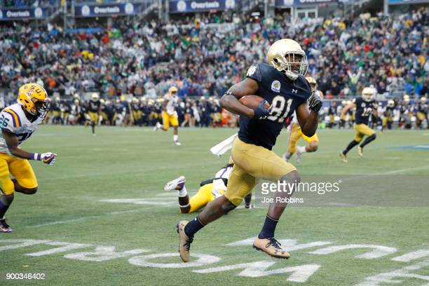 Miles Boykin of the Notre Dame Fighting Irish gets away from LSU Tigers defenders for the gamewinning 55yard touchdown in the fourth quarter of the...