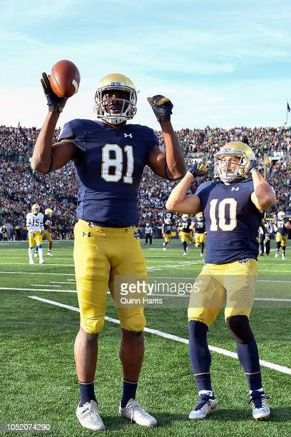 Miles Boykin of the Notre Dame Fighting Irish reacts with Chris Finke after scoring the touchdown to take the lead against the Pittsburgh Panthers in...