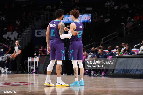 Miles Bridges and LaMelo Ball of the Charlotte Hornets talk during the game against the Washington Wizards on May 16, 2021 at Capital One Arena in...