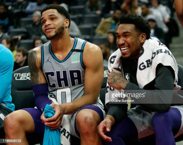 Miles Bridges and Malik Monk of the Charlotte Hornets watch from the bench during the second half of a 8776 win over the Detroit Pistons at Little...