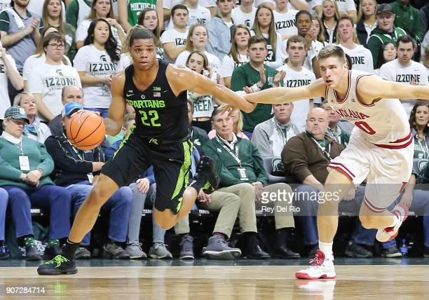 Miles Bridges drives to the basket while defended by Collin Hartman of the Indiana Hoosiers at Breslin Center on January 19 2018 in East Lansing...