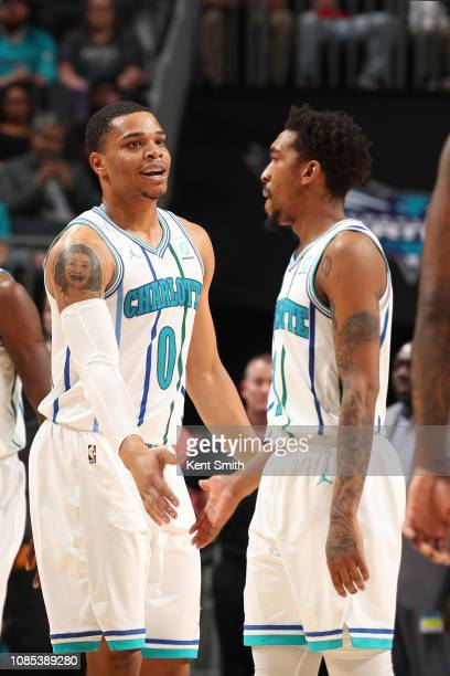 Miles Bridges hi-fives Malik Monk of the Charlotte Hornets on January 19, 2019 at Spectrum Center in Charlotte, North Carolina. NOTE TO USER: User...