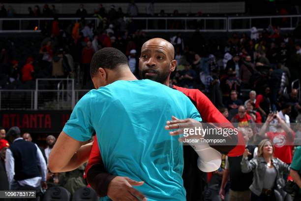 Miles Bridges of the Charlotte Hornets and Vince Carter of the Atlanta Hawks hug after the game on February 9 2019 at State Farm Arena in Atlanta...
