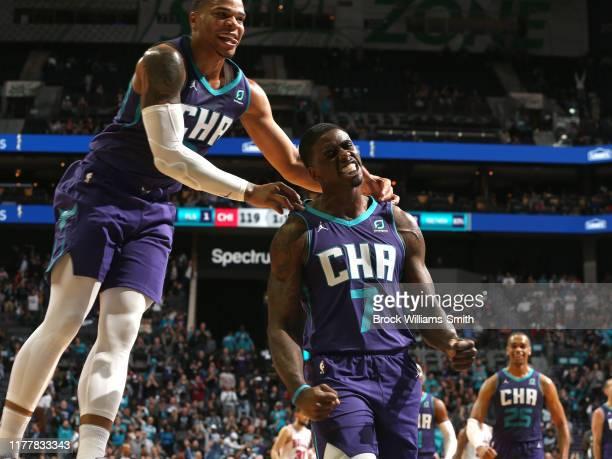 Miles Bridges of the Charlotte Hornets celebrates with Dwayne Bacon of the Charlotte Hornets during the game against the Chicago Bulls on October 23...