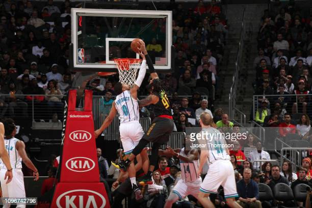 Miles Bridges of the Charlotte Hornets contests the shot by DeAndre' Bembry of the Atlanta Hawks on February 9 2019 at State Farm Arena in Atlanta...