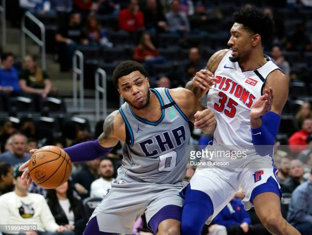Miles Bridges of the Charlotte Hornets drives against Christian Wood of the Detroit Pistons during the first half at Little Caesars Arena on February...