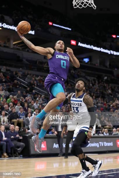 Miles Bridges of the Charlotte Hornets dunks the ball against the Minnesota Timberwolves on December 5 2018 at Target Center in Minneapolis Minnesota...