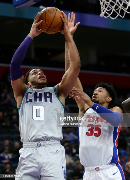 Miles Bridges of the Charlotte Hornets goes to the basket against Christian Wood of the Detroit Pistons during the first half at Little Caesars Arena...