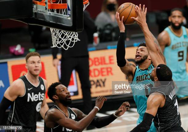 Miles Bridges of the Charlotte Hornets goes to the basket as Bruce Brown and Jeff Green of the Brooklyn Nets defend during the second half at...