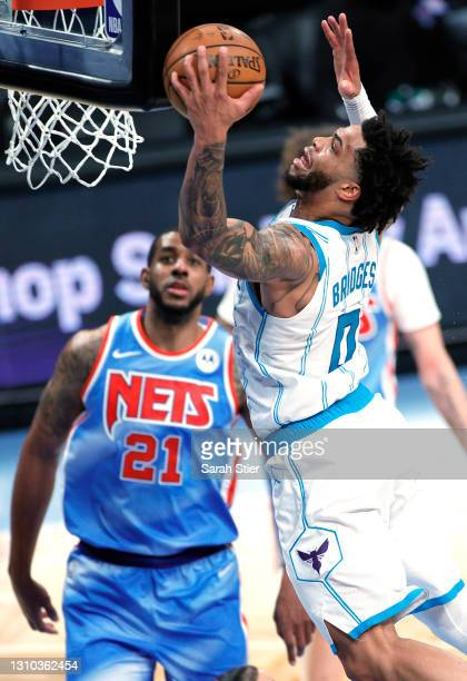 Miles Bridges of the Charlotte Hornets goes to the basket as LaMarcus Aldridge of the Brooklyn Nets looks on during the second half at Barclays...