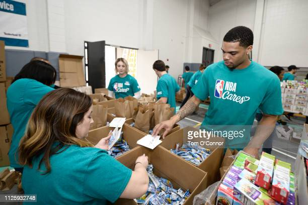 Miles Bridges of the Charlotte Hornets participates during the 2019 NBA Cares AllStar Day of Service at Second Harvest Food Bank of Metrolina on...