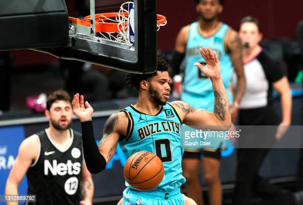 Miles Bridges of the Charlotte Hornets reacts after dunking the ball during the second half against the Brooklyn Nets at Barclays Center on April 16,...