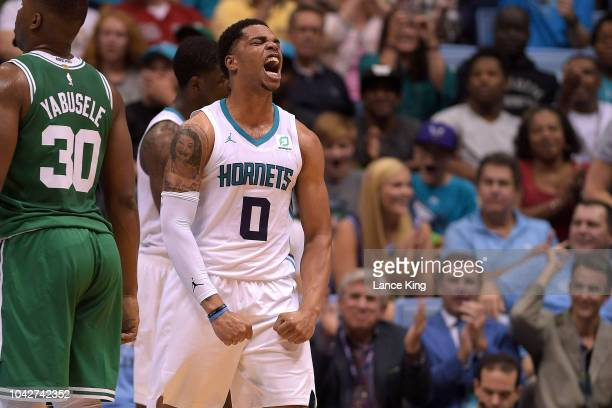 Miles Bridges of the Charlotte Hornets reacts following a play against the Boston Celtics in the fourth quarter during a preseason game at Dean Smith...