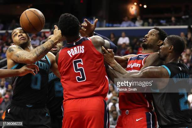 Miles Bridges of the Charlotte Hornets tries to grab a rebound in front of Bobby Portis of the Washington Wizards during the second half at Capital...