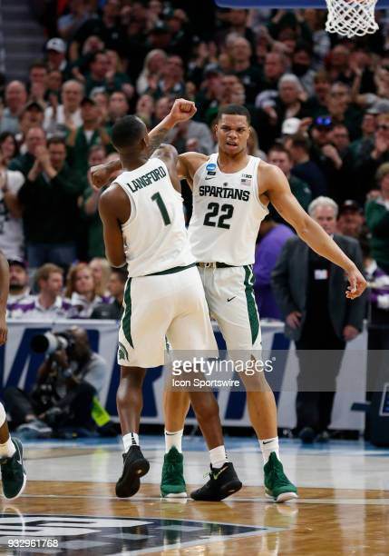 Miles Bridges of the Michigan State Spartans and G celebrate during the NCAA Division I Men's Basketball Championship First Round game between the...