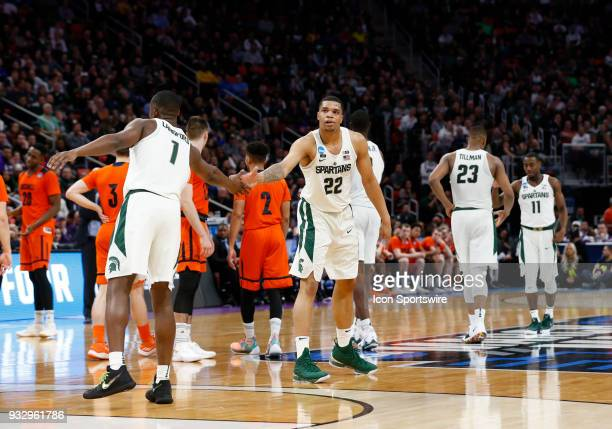 Miles Bridges of the Michigan State Spartans and G Joshua Langford of the Michigan State Spartans celebrate during the NCAA Division I Men's...
