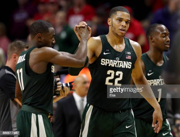 Miles Bridges of the Michigan State Spartans and teammate Lourawls Nairn Jr #11 celebrate the win over Rutgers Scarlet Knights on December 5 2017 at...