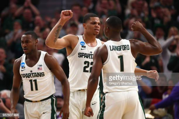 Miles Bridges of the Michigan State Spartans celebrates with Joshua Langford during the second half against the Bucknell Bison in the first round of...
