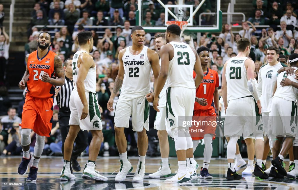 Miles Bridges #22 of the Michigan State Spartans celebrates with Xavier Tilman #23 of the Michigan State Spartans late in the game against the Illinois Fighting Illini at Breslin Center on February 20, 2018 in East Lansing, Michigan.